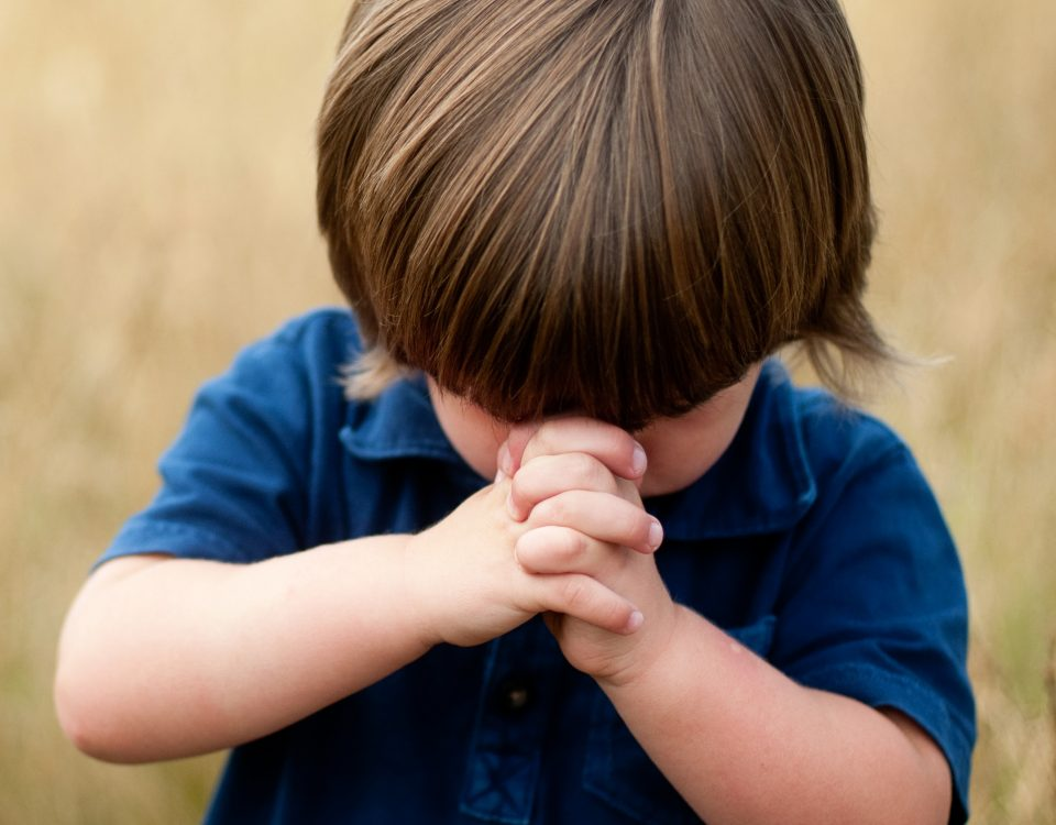 Toddler praying
