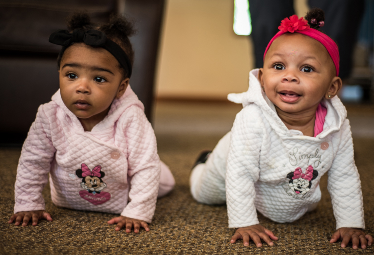 Two adorable babies crawling